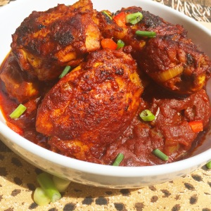 Zimbabwean Chicken Stew Ingredients 1/2 cup oil 8-10 chicken pieces 1 cup passata tomatoes/chopped tomatoes  1 medium onion chopped 2 spring onions chopped 2 Teaspoons minced garlic 1/2 Teaspoon dried thyme 1 Tablespoon paprika ¼ Teaspoon curry powder 1 tablespoon maggi granules  1 tablespoon dried parsley  Salt and pepper to taste Method  Season chicken with, paprika, turmeric, salt and pepper. Set aside. In a large skillet, heat oil over medium heat, add 1 teaspoon of the minced garlic and let it release its flavours until the oil is garlic infused. Add the chicken and fry slowly, taking out any browned bits off the bottom of the pot, until chicken is brown. If using fresh tomatoes blend tomatoes, onions, the other teaspoon of garlic, and onions. Pour the mixture in the pot of chicken, bring to a boil and let it simmer until tender (depending on the chicken) about 20- 30 minutes, frequently stirring the saucepan to prevent burns. If using passata tomatoes, add the onion, sauté until tender, about 4-5- minutes. Pour tomatoes , curry powder, thyme, garlic and the maggie. Bring to a boil and let it simmer for about 20-30 minutes. Adjust  thickness of soup with water or stock. Season with salt according to preference. Once cooked, garnish with spring onion and serve.